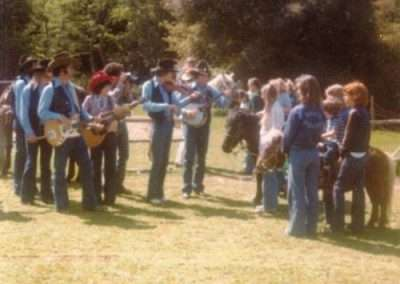 Historical photo of family and people playing banjo and guitar